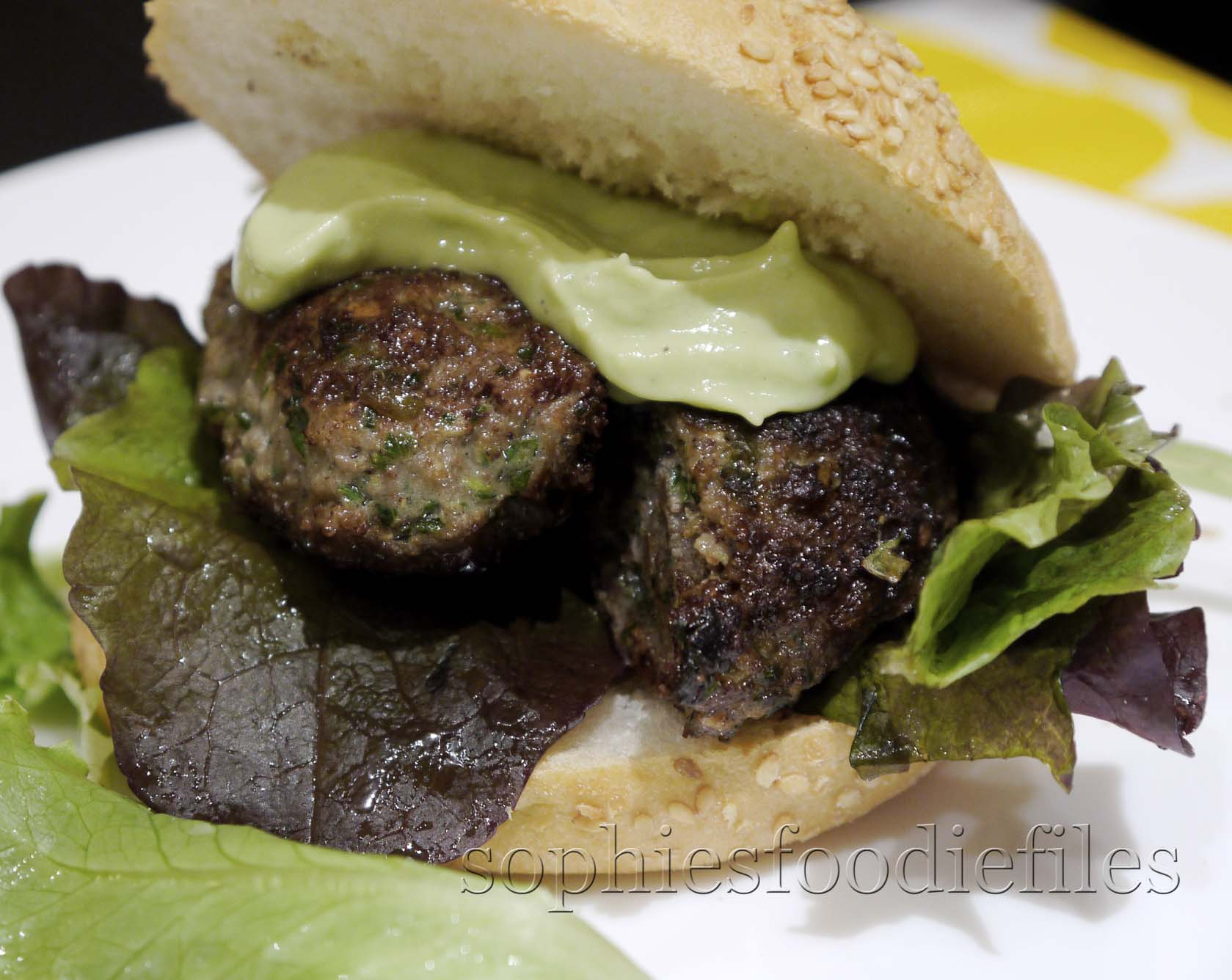 divine, juicy lamb burger topped with a tasty green avocado ...