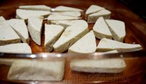 The pressed tofu cut into 10 thicker slices & the cut into 2 triangles: becoming 20 pieces!