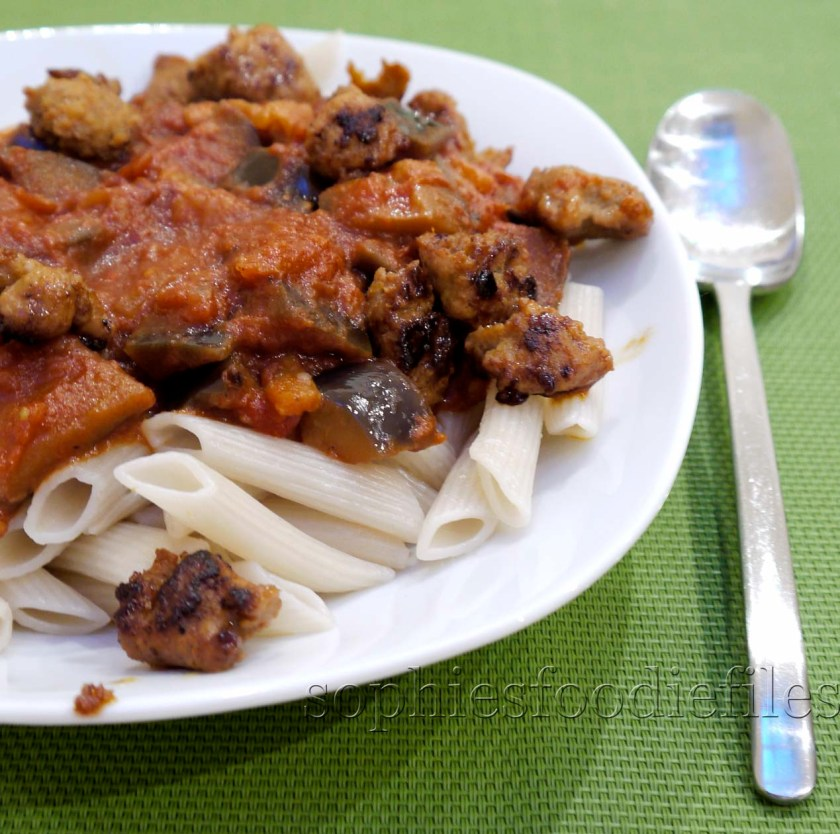 A tasty vegan auberine tomato stew, on a bed of spelt penne & spicy organic sausage bits!