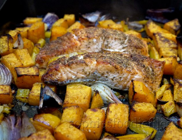 A delightful dinner! Roasted salmon on a bed of spiced veggies!