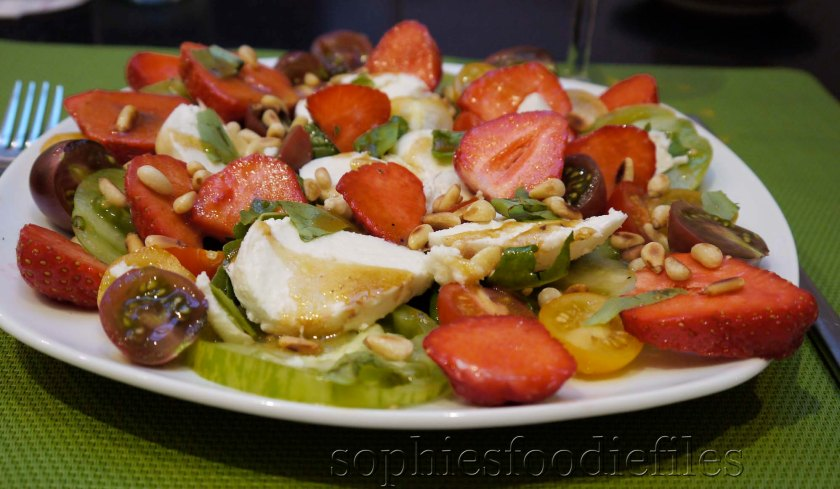 A divine Seasonal strawberry, Buffalo mozzerella, muliticoloured tomato salad!
