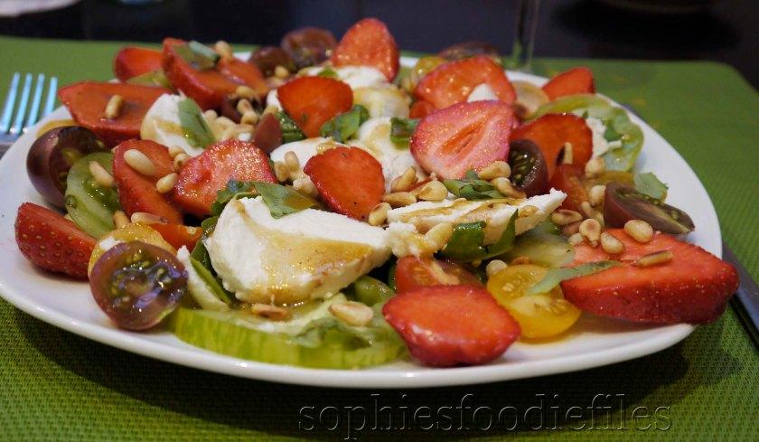 A divine Seasonal strawberry, Buffalo mozzerella, muliticoloured tomato salad!