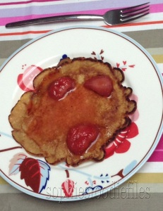 Spelt pancakes served with hot maple syrup strawberries!