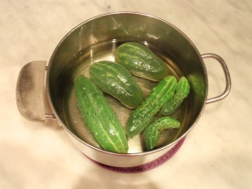 Salting the gherkins the night before!